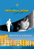 """Primo piano di una bambina, il logo di """"Angeli Custodi"""" e case disegnate sullo sfondo"""