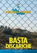 Rete protettiva e sullo sfondo una discarica di rifiuti