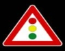 Un cartello stradale indicante un semaforo